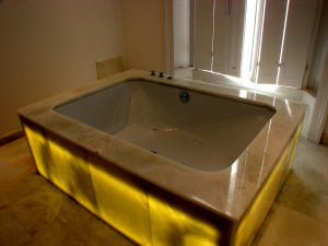 Back-lit White Onyx Bath Surround  and side Panels - Holland Park House