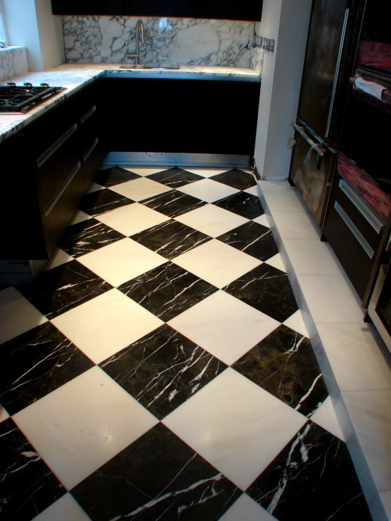 Book match stone marble onyx floors walls nature fusion baker street london exective flats entrnace hall milaswhite nero marquina marble chequered pattern floor tiles installed dailygadgetfo Gallery