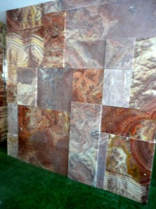 Rosso Onyx Wall - uneven surface, polished and honed slabs are mixed